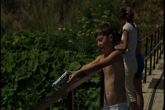 """Young boy with gun / """"View From the Bridge"""""""